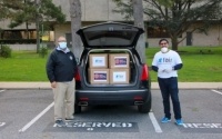 Senator Kevin Thomas, left, and Imran Pasha, Chairman of the Federation of American Indian Relief, delivered 500 N95 masks to Nassau University Medical Center last week.