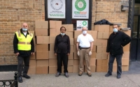 Representatives from Rethink Food NYC, Otto Brehm Inc INCA Relief & Albanian American Open Hang Association Inc. stand by packages of meals
