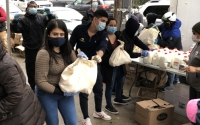 State Senator Jessica Ramos handing food out in front of her district office