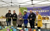 Senator Krueger cutting the ribbon at the Kips Bay Greenmarket