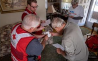 American Red Cross staff show homeowners how to prepare their home for fire safety.