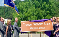 The parents of Trooper Nicholas Clark unveil the new memorial sign at yesterday's ceremony.