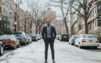 Image of Senator Myrie on a residential street in the 20th District.