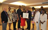 Senator Montgomery, Assemblyman Walter Mosley and Assemblywoman Latrice Walker present members of MCU's Board of Directors with a Legislative Resolution commemorating the 100th Anniversary.