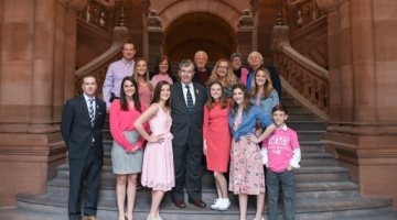 The founders of the Real Kids Wear Pink Campaign with their families and friends on the Million Dollar Staircase