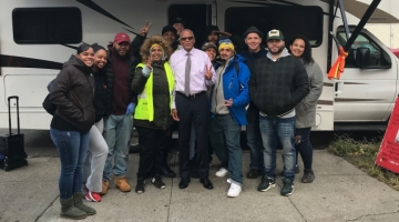 Senator Jackson poses for a photo outside the Winnebago used by the Washington Heights Corner Project for harm reduction work with drug users.