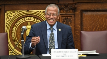 Senator Jackson gives a thumbs up during a light moment at a hearing in Brooklyn