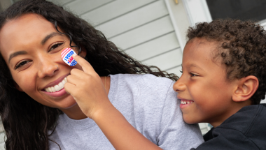Child places early voting sticker