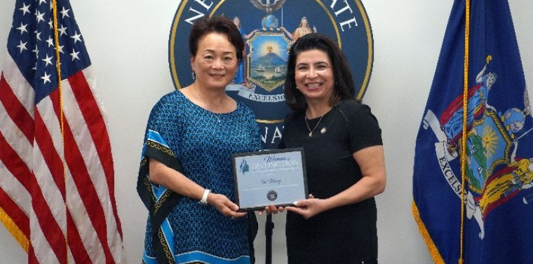 """New York State Sen. Anna Kaplan (D-North Hills) presented the 2021 """"Woman of Distinction"""" award to Sands Point resident Tai Wang at a Sept. 9 ceremony. (Sen. Anna Kaplan's Office)"""