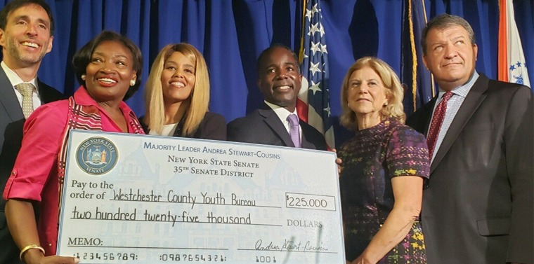 NYS Senate Majority Leader Andrea Stewart-Cousins with State Senator Shelley Mayer presenting $225,000 check to County Executive George Latimer and Westchester County Youth Bureau Executive Director Dr. DaMia Harris-Madden with New Rochelle Mayor Noam Bramson and Mount Vernon Mayor Andre Wallace in attendance.