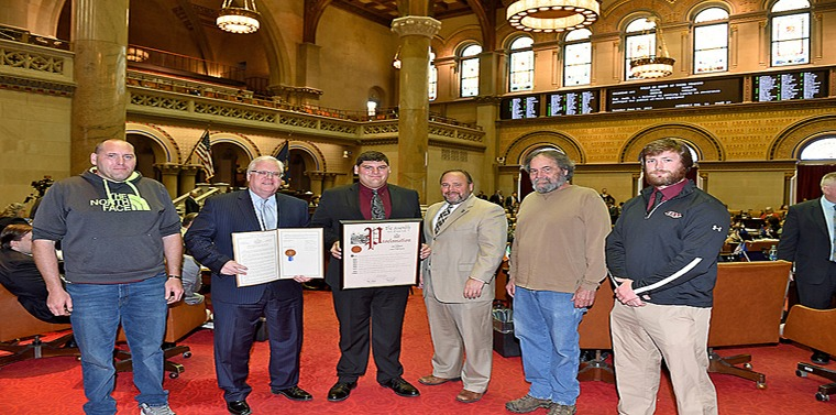In the photo above in the Assembly Chamber on Tuesday, June 4, from left to right: Chris Houseknecht (Dylan's father), Senator O'Mara, Dylan Houseknecht, Assemblyman Palmesano, Scott Houseknecht (Dylan's grandfather), and Coach Dan Batchelder.