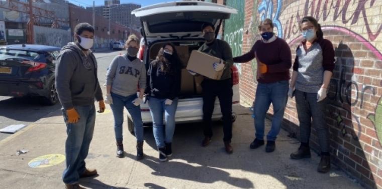 Team Salazar Loading Food Boxes For Distribution