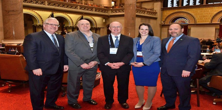 In the photo above in the state Assembly Chamber, from left to right: Senator O'Mara, Corning City Manager Mark Ryckman, Corning Mayor Bill Boland, Corning City Councilmember Alison Hunt, and Assemblyman Palmesano.