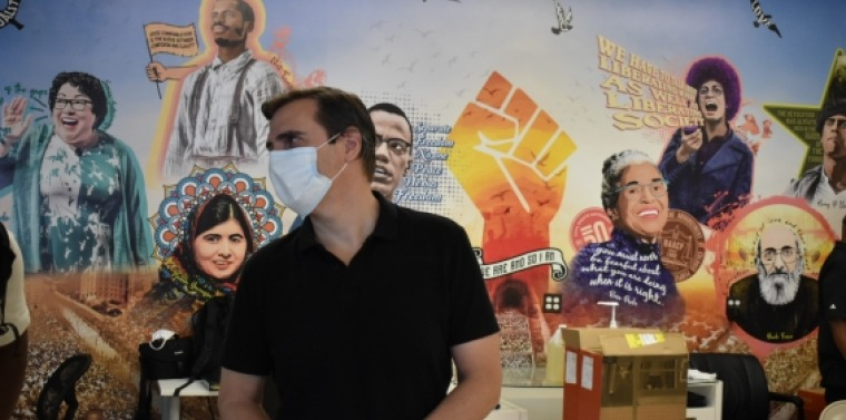 Senator Gianaris standing in front of a mural at Queensbridge 696