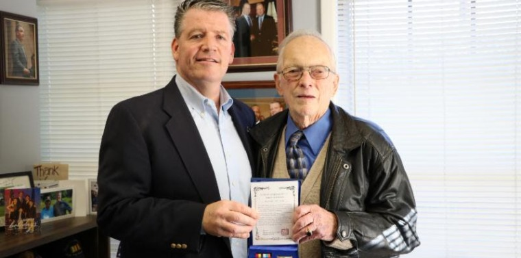 2018 Mackey Amb. Peace Medal Senator Terrence Murphy presents George Mackey of Beekman with the Ambassador of Peace Medal for his service during the Korean War.